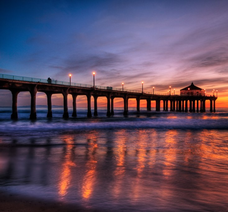 Relax and watch the sunset over the beautiful blue water at a Los Angeles beach.